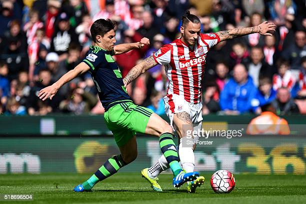 Marko Arnautovic of Stoke City and Jack Cork of Swansea City compete for the ball during the Barclays Premier League match between Stoke City and...