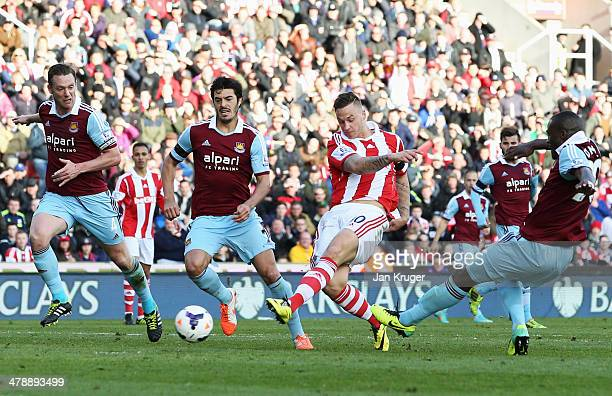 Marko Arnautovic of Stoke City beats Kevin Nolan James Tomkins and Guy Demel of West Ham United to score their second goal during the Barclays...
