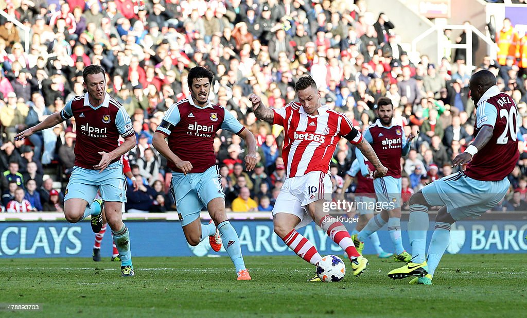 <a gi-track='captionPersonalityLinkClicked' href=/galleries/search?phrase=Marko+Arnautovic&family=editorial&specificpeople=5567995 ng-click='$event.stopPropagation()'>Marko Arnautovic</a> of Stoke City beats <a gi-track='captionPersonalityLinkClicked' href=/galleries/search?phrase=Kevin+Nolan&family=editorial&specificpeople=206775 ng-click='$event.stopPropagation()'>Kevin Nolan</a> (L), James Tomkins (2L) to score their second goal during the Barclays Premier League match between Stoke City and West Ham United at Britannia Stadium on March 15, 2014 in Stoke on Trent, England.