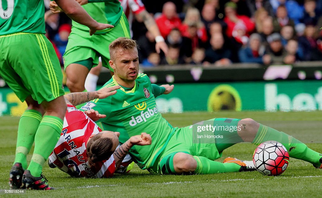 Marko Arnautovic (L) of Stoke City brings down Jan Kirchhoff of Sunderland during the Barclays Premier League match between Stoke City and Sunderland at The Britannia Stadium on April 30, 2016 in Stoke on Trent , England.