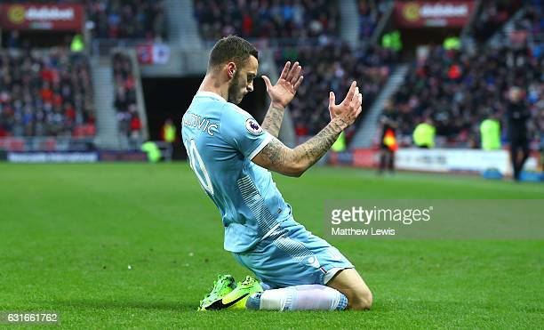 Marko Arnautovic of Stoke City celebrates scoring his sides first goal during the Premier League match between Sunderland and Stoke City at Stadium...