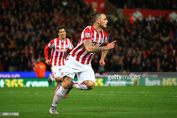 Marko Arnautovic of Stoke City celebrates scoring his team's first goal during the Barclays Premier League match between Stoke City and Chelsea at...