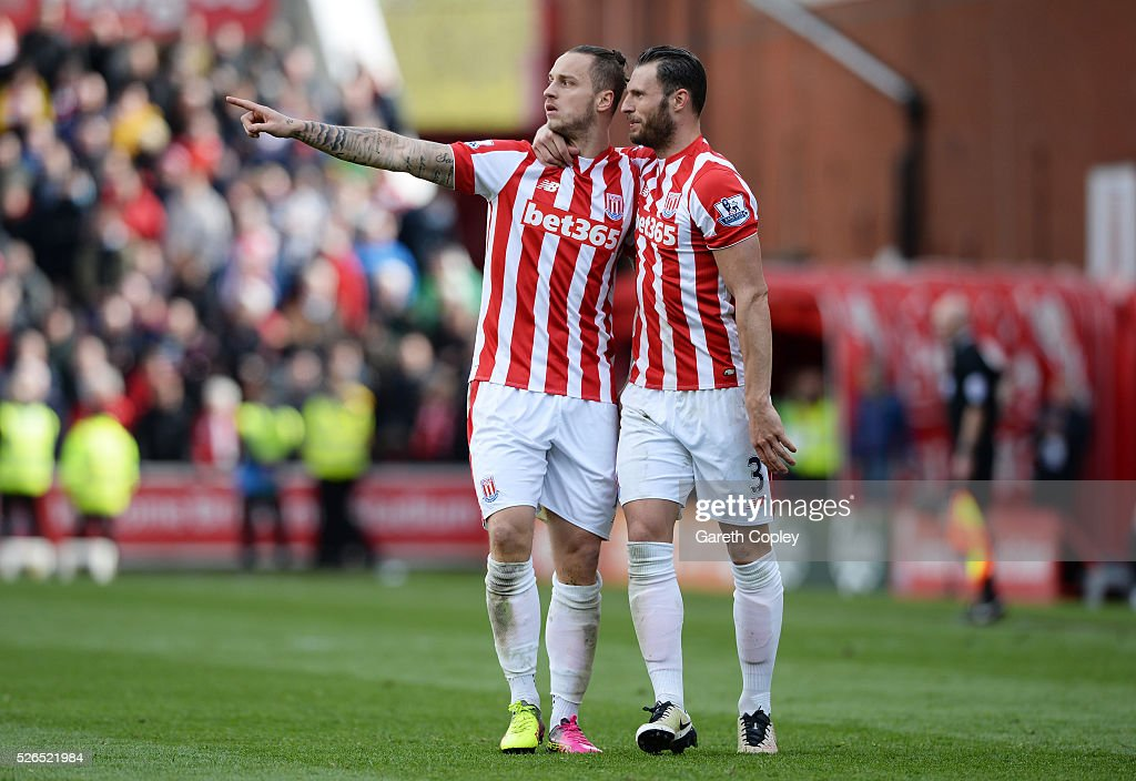 Marko Arnautovic (L) of Stoke City celebrates scoring his team's first goal with his team mate Erik Pieters (R) during the Barclays Premier League match between Stoke City and Sunderland at the Britannia Stadium on April 30, 2016 in Stoke on Trent, England.