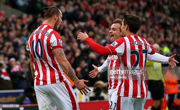 Marko Arnautovic of Stoke City celebrates scoring his team's second goal with his team mates Xherdan Shaqiri and Bojan Krkic during the Barclays...