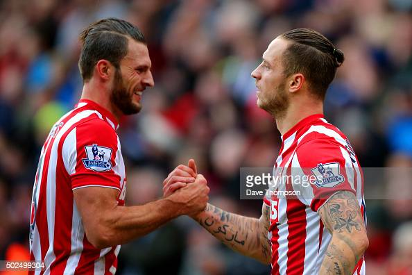 Marko Arnautovic of Stoke City celebrates with teammate Erik Pieters after scoring his team's second goal during the Barclays Premier League match...