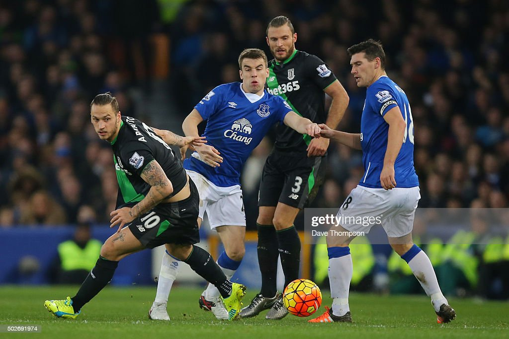 Marko Arnautovic (1st L) of Stoke City competes for the ball against Seamus Coleman (2nd L) and Gareth Barry (1st Rof Everton during the Barclays Premier League match between Everton and Stoke City at Goodison Park on December 28, 2015 in Liverpool, England.