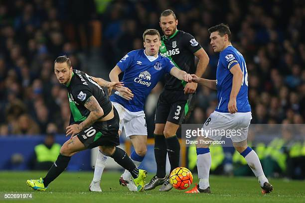 Marko Arnautovic of Stoke City competes for the ball against Seamus Coleman and Gareth Barry 1st Rof Everton during the Barclays Premier League match...