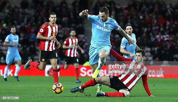 Marko Arnautovic of Stoke City escapes a challenge from Donald Love of Sunderland during the Premier League match between Sunderland and Stoke City...