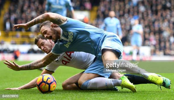 Marko Arnautovic of Stoke City is challenegd by Jan Vertonghen of Tottenham Hotspur during the Premier League match between Tottenham Hotspur and...