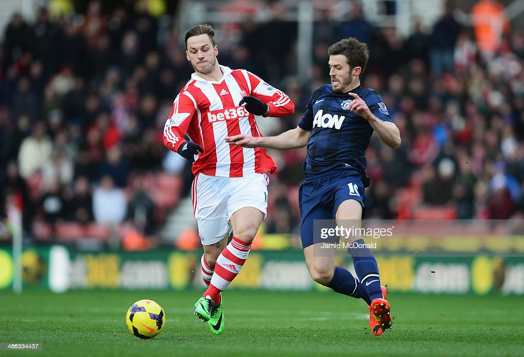 Marko Arnautovic of Stoke City is closed down by Michael Carrick of Manchester United during the Barclays Premier League match between Stoke City and Manchester United at Britannia Stadium on February 1, 2014 in Stoke on Trent, England.