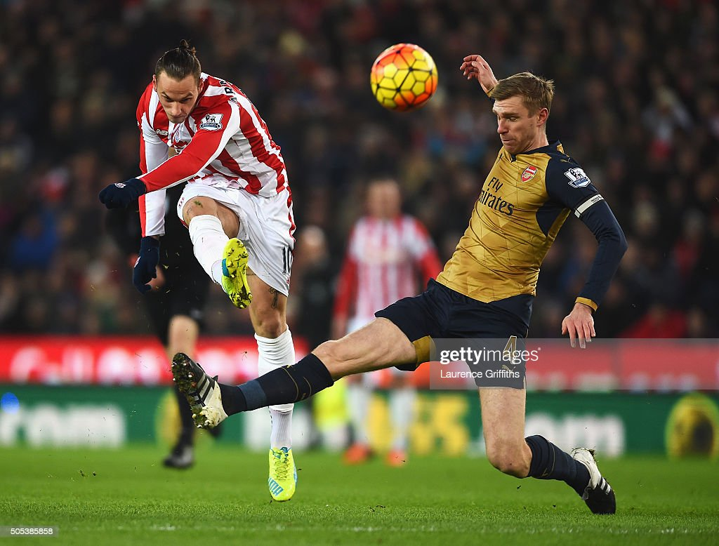 Marko Arnautovic of Stoke City is closed down by Per Mertesacker of Arsenal during the Barclays Premier League match between Stoke City and Arsenal at Britannia Stadium on January 17, 2016 in Stoke on Trent, England.