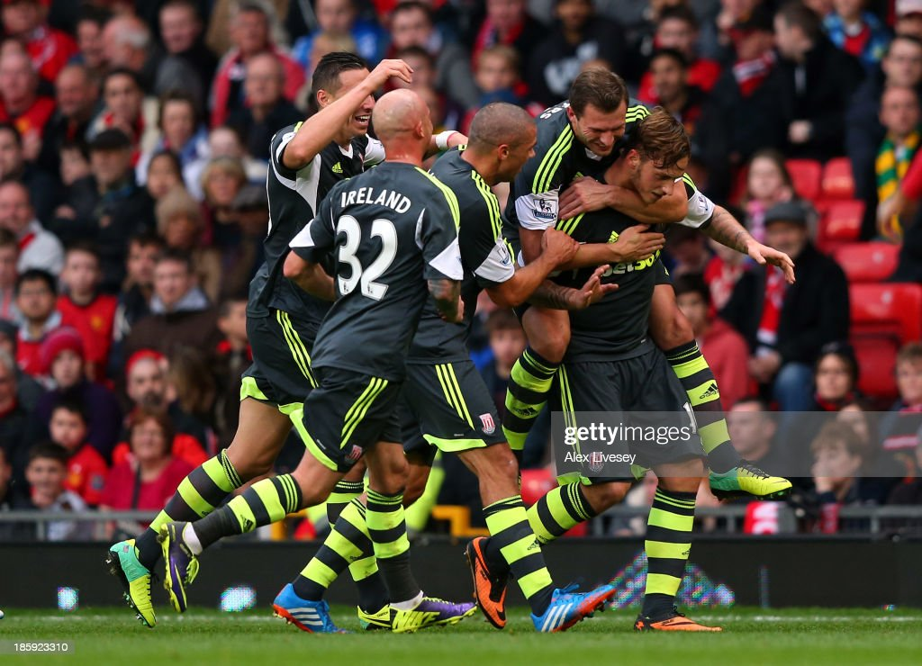 <a gi-track='captionPersonalityLinkClicked' href=/galleries/search?phrase=Marko+Arnautovic&family=editorial&specificpeople=5567995 ng-click='$event.stopPropagation()'>Marko Arnautovic</a> of Stoke City is mobbed by team mates after scoring his goal from a free kick during the Barclays Premier League match between Manchester United and Stoke City at Old Trafford on October 26, 2013 in Manchester, England.