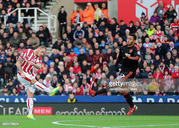Marko Arnautovic of Stoke City scores a goal to make it 20 during the Barclays Premier League match between Stoke City and Manchester United at...