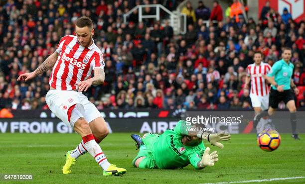 Marko Arnautovic of Stoke City scores his sides first goal past Victor Valdes of Middlesbrough during the Premier League match between Stoke City and...