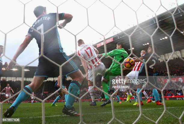 Marko Arnautovic of Stoke City scores his sides second goal past Victor Valdes of Middlesbrough during the Premier League match between Stoke City...