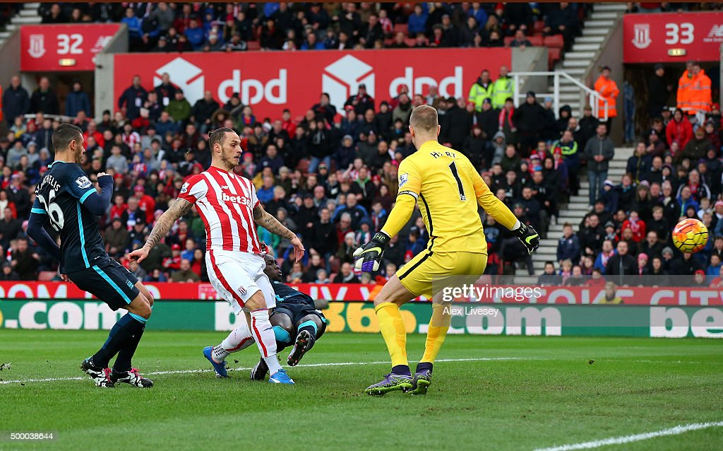 Marko Arnautovic (2nd L) of Stoke City scores his team's first goal during the Barclays Premier League match between Stoke City and Manchester City at Britannia Stadium on December 5, 2015 in Stoke on Trent, England.