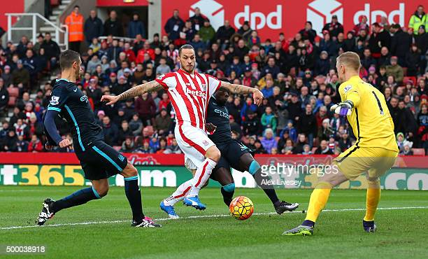 Marko Arnautovic of Stoke City scores his team's first goal during the Barclays Premier League match between Stoke City and Manchester City at...