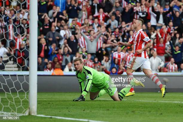 Marko Arnautovic of Stoke City shoots and scores past David Stockdale the Fulham goalkeeper during the Barclays Premier League match between Stoke...