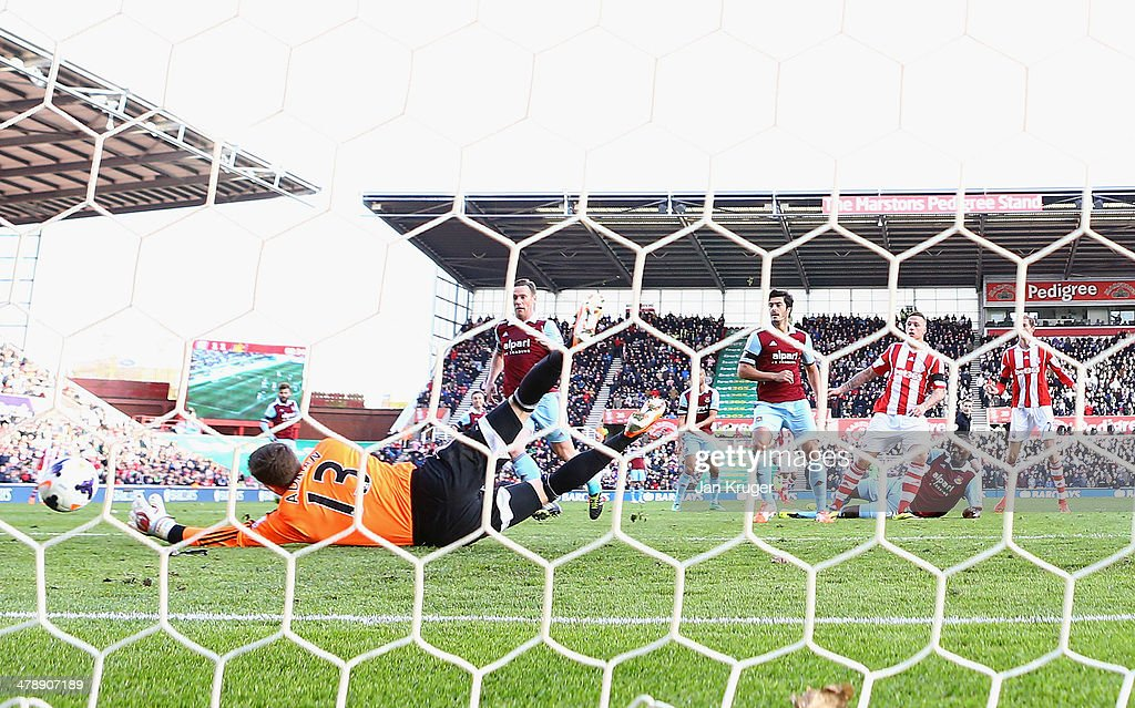 Marko Arnautovic of Stoke City shoots past Adrian of West Ham United to score their second goal during the Barclays Premier League match between Stoke City and West Ham United at Britannia Stadium on March 15, 2014 in Stoke on Trent, England.