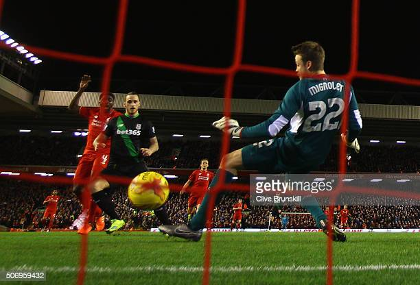 Marko Arnautovic of Stoke City shoots past goalkeeper Simon Mignolet of Liverpool to score their first goal during the Capital One Cup semi final...