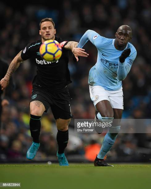 Marko Arnautovic of West Ham United and Eliaquim Mangala of Manchester City battle for possession during the Premier League match between Manchester...