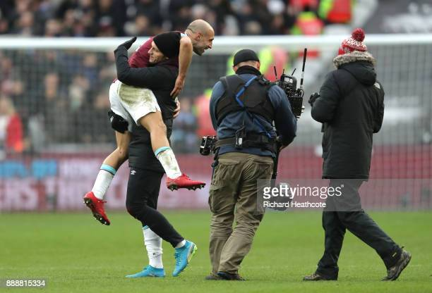 Marko Arnautovic of West Ham United and Pablo Zabaleta of West Ham United celebrate victory after the Premier League match between West Ham United...