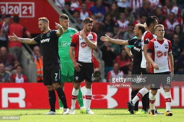 Marko Arnautovic of West Ham United reacts to being sent off as Jack Stephens of Southampton argues with Mark Noble of West Ham United during the...