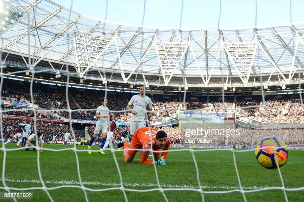 Marko Arnautovic of West Ham United scores his sides first goal past Thibaut Courtois of Chelsea during the Premier League match between West Ham...