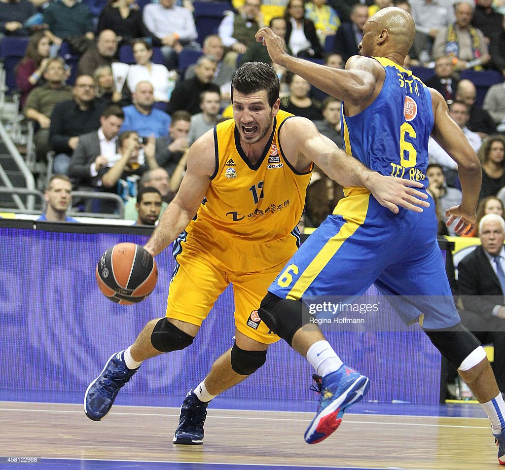 Marko Banic, #13 of Alba Berlin competes with Devin Smith, #6 of Maccabi Electra Tel Aviv during the 2014-2015 Turkish Airlines Euroleague Basketball Regular Season Date 3 game between Alba Berlin v Maccabi Electra Tel Aviv at O2 World on October 30, 2014 in Berlin, Germany.