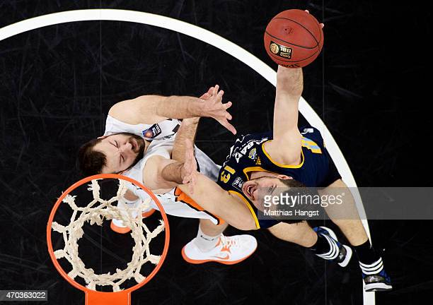 Marko Banic of Berlin in action against Ian Vougioukas of Ulm during the Beko Basketball Bundesliga match between Ratiopharm Ulm and Alba Berlin at...