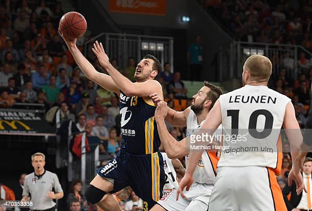 Marko Banic of Berlin is challenged by Ian Vougioukas of Ulm during the Beko Basketball Bundesliga match between Ratiopharm Ulm and Alba Berlin at...
