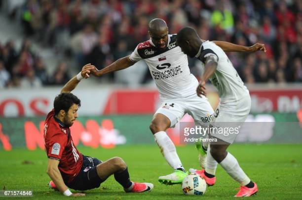 Marko Basa of Lille and Sloan Privat of Guingamp and Yannis Salibur of Guingamp during the Ligue 1 match between Lille OSC and EA Guingamp at Stade...