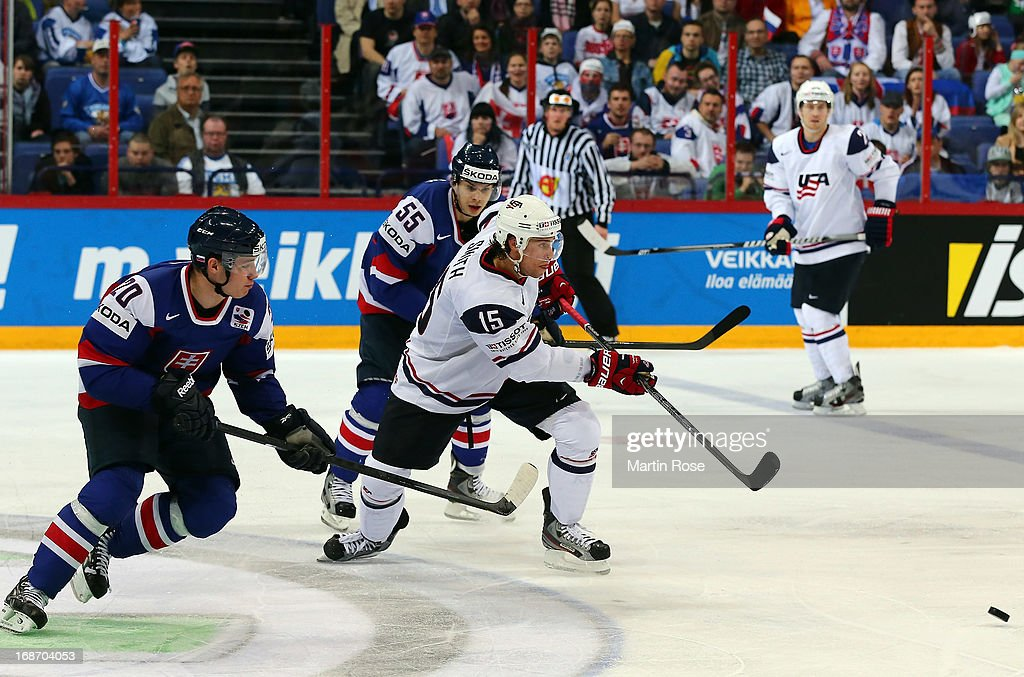 Marko Dano(L) of Slovakia and Craig Smith (R) of USA battle for the puck during the IIHF World Championship group H match between Slovakia and USA at Hartwall Areena on May 14, 2013 in Helsinki, Finland.