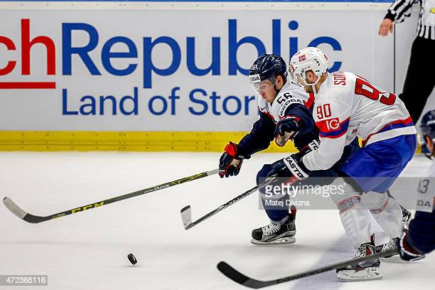 Marko Dano of Slovakia and Daniel Sorvik of Norway battle for the puck during the IIHF World Championship group B match between Slovakia and Norway...