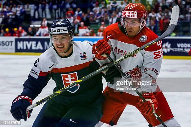 Marko Dano of Slovakia and Jesper Jensen of Denmark battle during the IIHF World Championship group B match between Slovakia and Denmark at CEZ Arena...