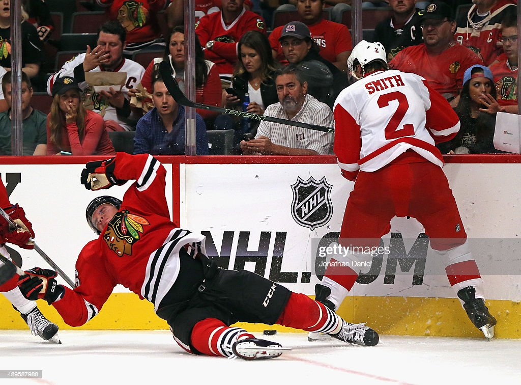 Marko Dano #56 of the Chicago Blackhawks hits the ice after colliding with <a gi-track='captionPersonalityLinkClicked' href=/galleries/search?phrase=Brendan+Smith+-+Ice+Hockey+Player&family=editorial&specificpeople=10537682 ng-click='$event.stopPropagation()'>Brendan Smith</a> #2 of the Detroit Red Wings during a preseason game at the United Center on September 22, 2015 in Chicago, Illinois.