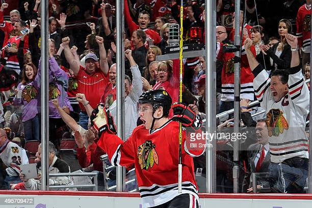 Marko Dano of the Chicago Blackhawks reacts after scoring against the St Louis Blues in the first period of the NHL game at the United Center on...