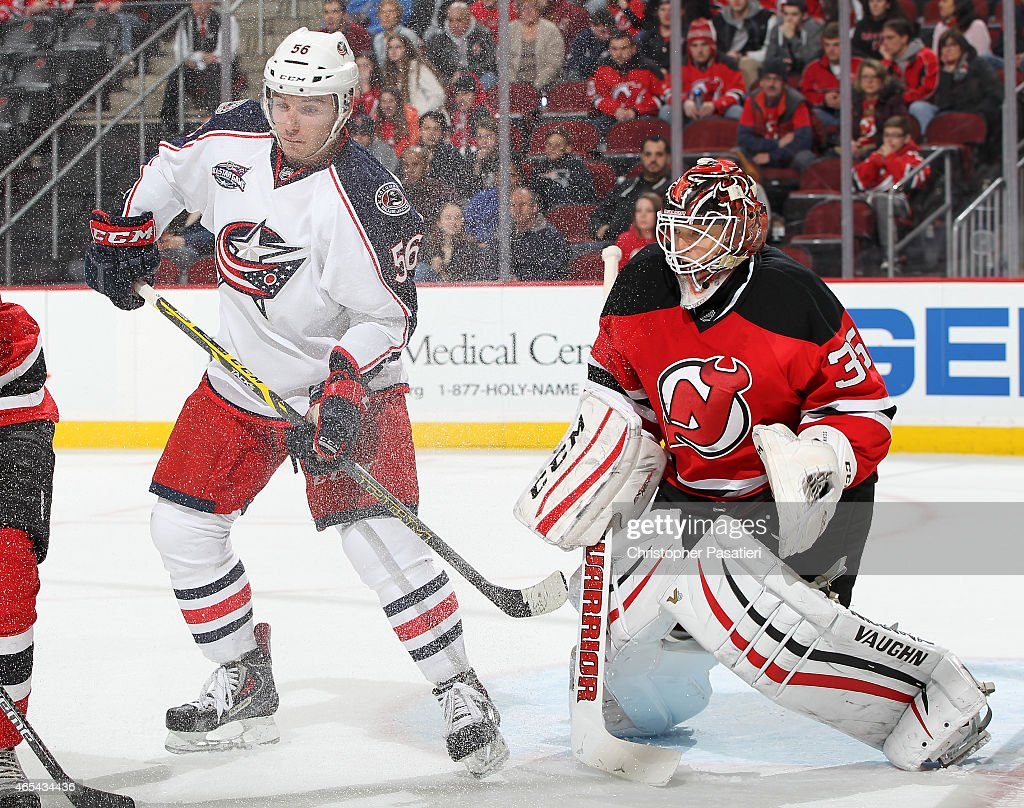 Marko Dano #56 of the Columbus Blue Jackets obstructs the view of Cory Schneider #35 of the New Jersey Devils during the third period at the Prudential Center on March 6, 2015 in Newark, New Jersey. The Blue Jackets defeated the Devils 3-2.