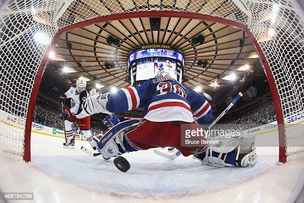 Marko Dano of the Columbus Blue Jackets scores at 1130 of the second period against Henrik Lundqvist of the New York Rangers at Madison Square Garden...