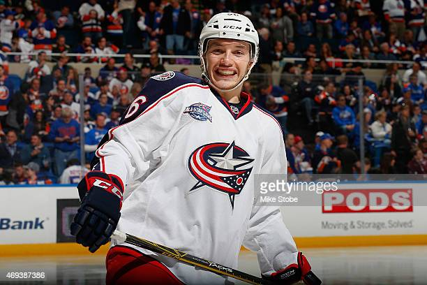 Marko Dano of the Columbus Blue Jackets smiles during a stoppage of play against the New York Islanders at Nassau Veterans Memorial Coliseum on April...