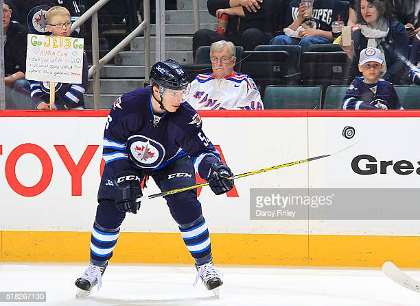 Marko Dano of the Winnipeg Jets bounces a puck on his stick during the pregame warm up prior to NHL action against the Ottawa Senators at the MTS...
