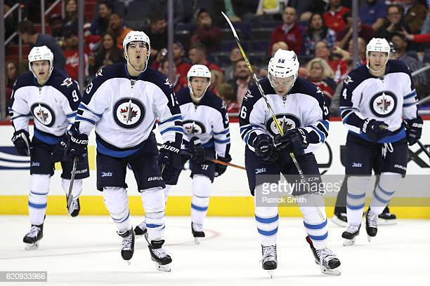 Marko Dano of the Winnipeg Jets celebrates with teammates after scoring a goal against the Washington Capitals during the third period at Verizon...