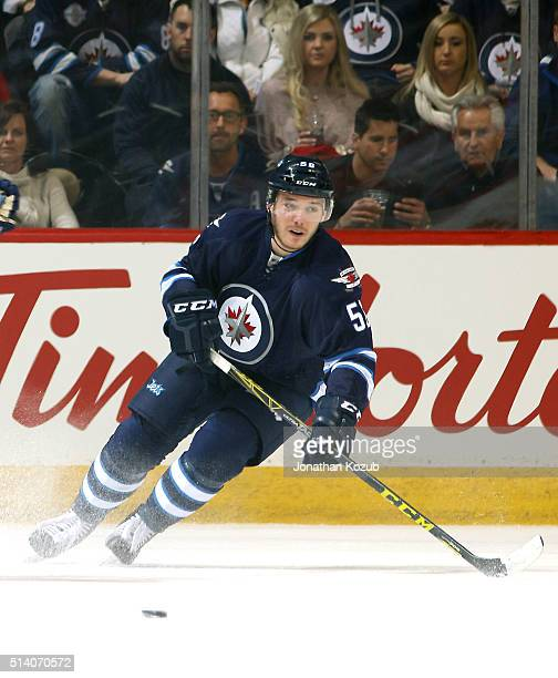 Marko Dano of the Winnipeg Jets follows the play up the ice during first period action against the Florida Panthers at the MTS Centre on March 1 2016...