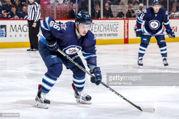 Marko Dano of the Winnipeg Jets gets set for a second period faceoff against the San Jose Sharks at the MTS Centre on March 6 2017 in Winnipeg...