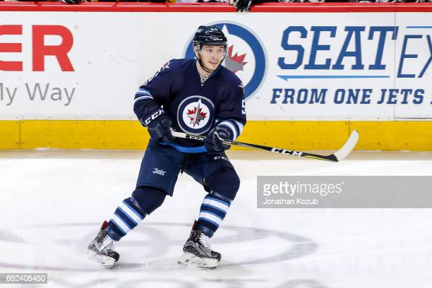 Marko Dano of the Winnipeg Jets keeps an eye on the play during third period action against the Pittsburgh Penguins at the MTS Centre on March 8 2017...