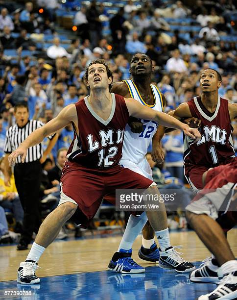 Marko Deric against UCLA Alfred Aboya during a college basketball game between the Loyola Marymount Lions and the UCLA Bruins played at Pauley...