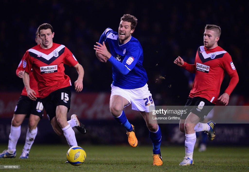 <a gi-track='captionPersonalityLinkClicked' href=/galleries/search?phrase=Marko+Futacs&family=editorial&specificpeople=5964146 ng-click='$event.stopPropagation()'>Marko Futacs</a> of Leicester City breaks from Adam Clayton of Huddersfield Town during the FA Cup with Budweiser Fourth Round replay match between Leicester City and Huddersfield Town at The King Power Stadium on February 12, 2013 in Leicester, England.