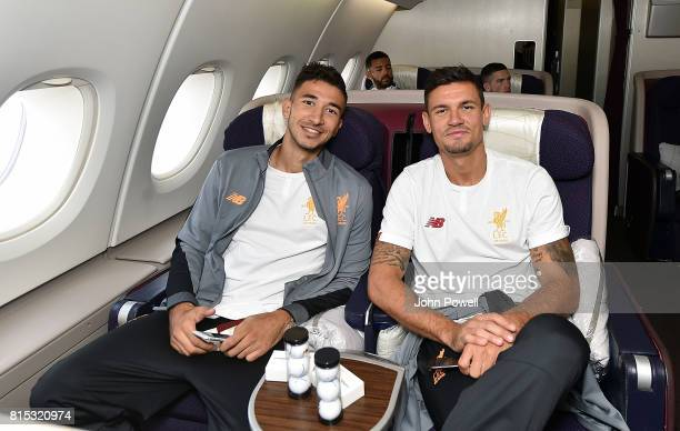 Marko Grujic and Dejan Lovren of Liverpool on the plane before pre season tour at Manchester Airport on July 16 2017 in Liverpool England