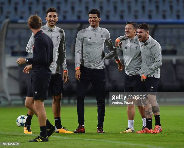 Marko Grujic Dominic Solanke Philippe Coutinho and Alberto Moreno of Liverpool during a training session at Stadion Ljudski vrt on October 16 2017 in...