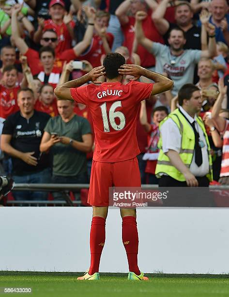 Marko Grujic of Liverpool celebrates after scoring the fourth goal during the International Champions Cup match between Liverpool and Barcelona at...